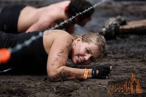 tough-mudder_kiss-of-mud_barbed-wire-crawl_mountain-climbers_determination